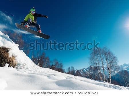 Man on Snowboard Riding on Hill, Extreme Sport Stock photo © robuart