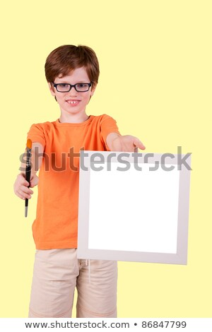 cute boy and happy with a paintbrush and a blank slate Stock photo © alexandrenunes