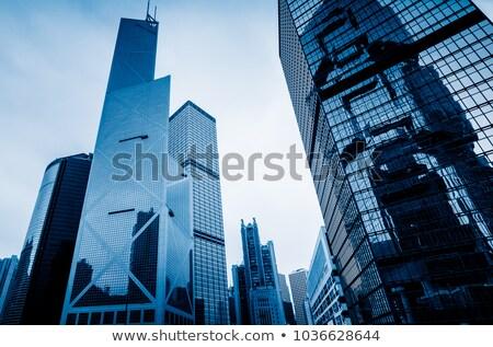 moderne · wolkenkrabber · muur · zon · licht - stockfoto © dsmsoft