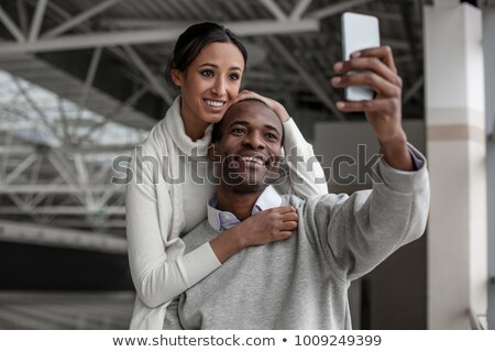 Portrait of young couple standing together at airport hall and l Stock photo © HASLOO