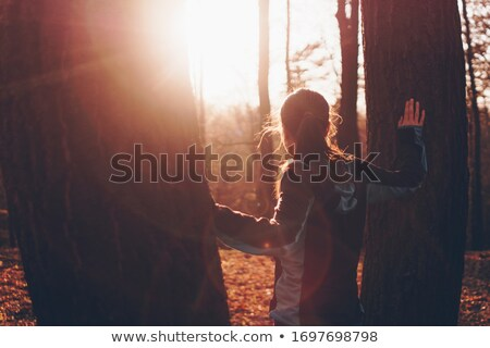a sporty woman between two trees Stock photo © photography33