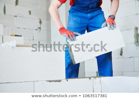 Builder with a block wall Stock photo © photography33