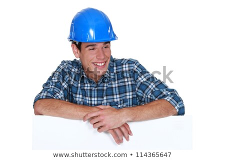 Smiling chap wearing a hardhat Stock photo © photography33