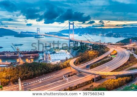 híd · naplemente · pillanat · égbolt · víz · épület - stock fotó © kawing921