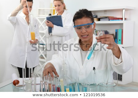 female trio in lab with test-tubes Stock photo © photography33