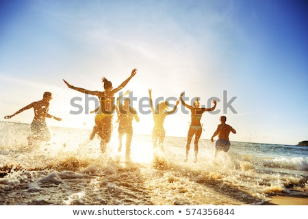 Youth group on the beach Stock photo © photography33
