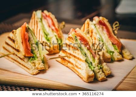 свежие вкусный трехслойный бутерброд сыра ветчиной таблице Сток-фото © juniart