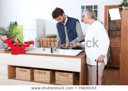 young man fixing faucet older woman Stock photo © photography33