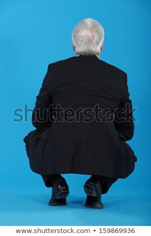 Stock fotó: Idős · üzletember · guggol · hát · kamerába · háttér