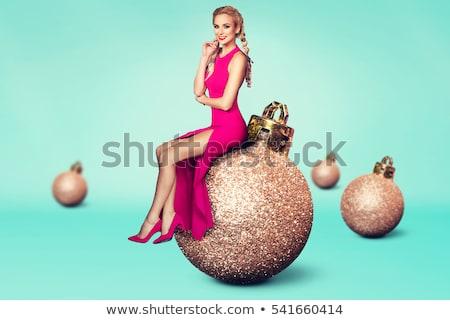 lovely woman with christmas balls Stock photo © dolgachov