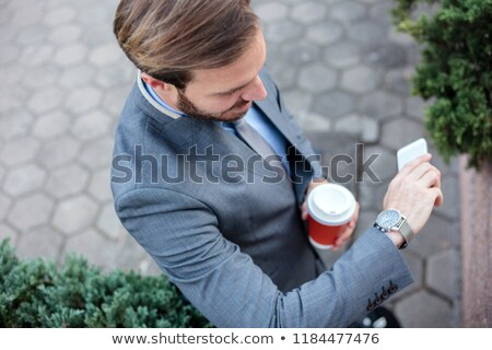 Smiling ethnic businessman drinking a coffee  Stock photo © wavebreak_media