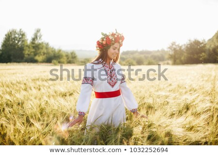 Attractive woman in the Ukrainian national clothes Stock photo © acidgrey