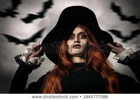 portrait of angry lady with a bat stock photo © acidgrey