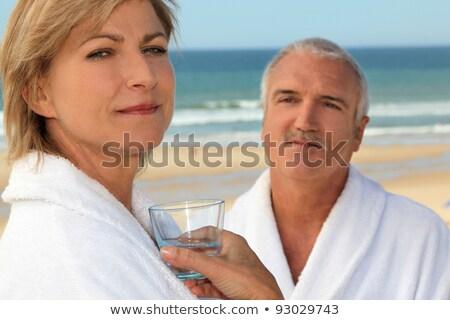 Coppia indossare accoppiamento esterna acqua felice Foto d'archivio © photography33