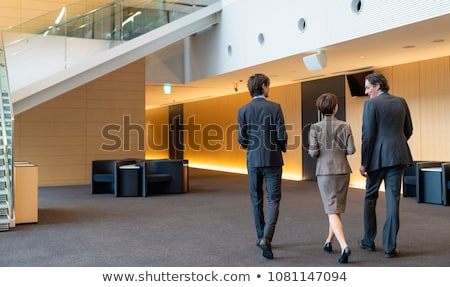 back view of a business man welcoming Stock photo © feedough