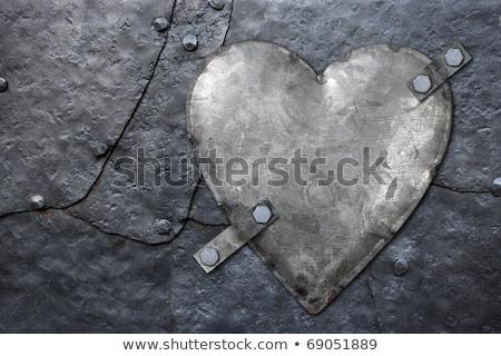 Metal heart on rusty background Stock photo © sumners