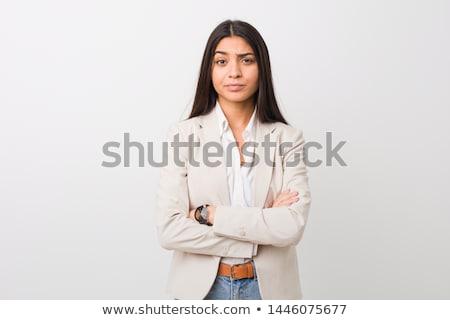 Infeliz mulher jovem olhando câmera branco estudante Foto stock © wavebreak_media