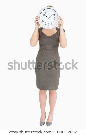 Kobieta zegar ukrywanie głowie biały Zdjęcia stock © wavebreak_media