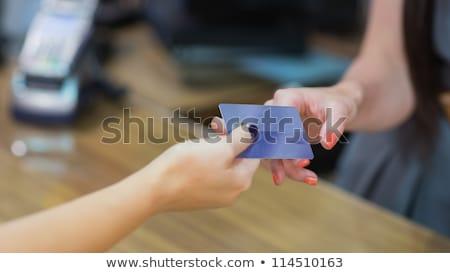 女性 · クレジットカード · 服 · ストア · 手 · 笑顔 - ストックフォト © wavebreak_media