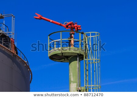 fire hose nozzle at an oil gas heavy industry plant stock photo © bertl123