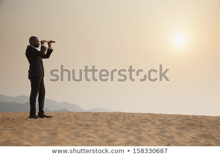 Side view of man holding telescope Stock photo © zzve