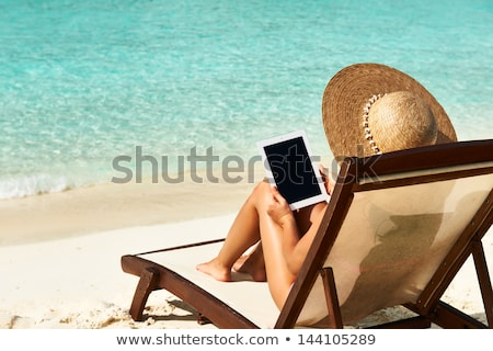 Woman relaxing on sunbed with tablet Stock photo © Witthaya