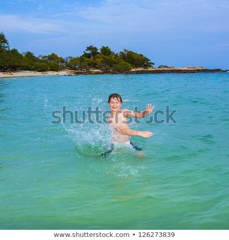 Guapo nino mano tropicales diversión océano Foto stock © meinzahn