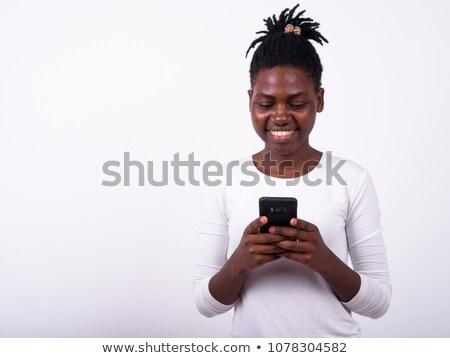 Hippie girl using mobile phone Stock photo © Witthaya