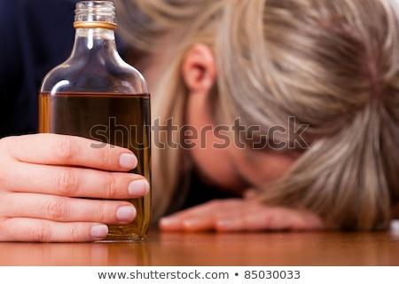 Alcohol abuso mujer potable brandy sesión Foto stock © Kzenon