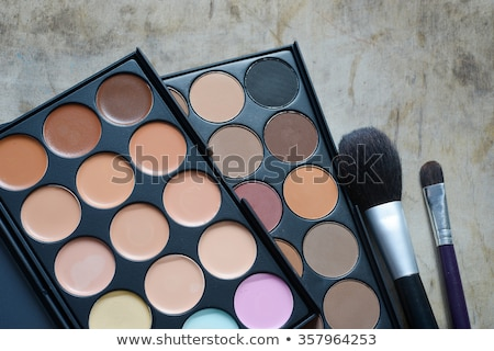 closeup of beautiful eyes with makeup kit and glamorous makeup stock photo © vlad_star