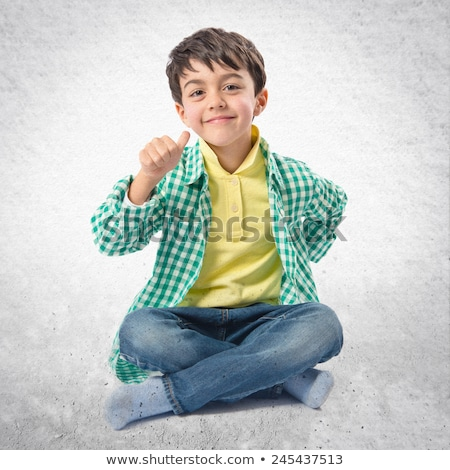 seated young casual man making a face  Stock photo © feedough