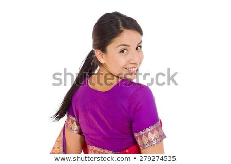 Indian young woman turning back isolated on white background Stock photo © bmonteny