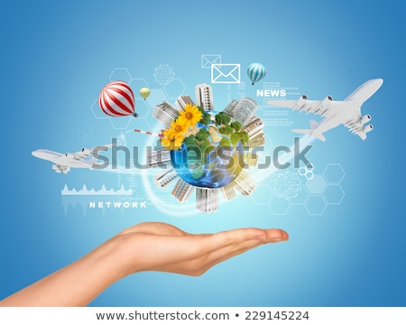 woman hand hold earth with buildings and airplane stock photo © cherezoff
