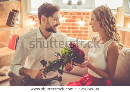 portre · gülümseyen · kadın · güller · ev · çiçek - stok fotoğraf © feedough