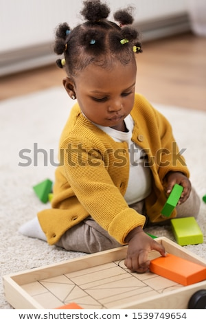adorable toddler baby girl playing stock photo © dariazu
