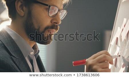 серьезный бизнесмен маркер Дать белый Сток-фото © wavebreak_media