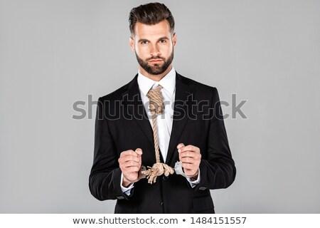 Handsome businessman wearing handcuffs Stock photo © wavebreak_media