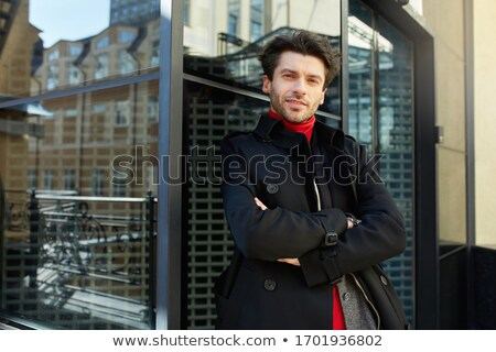 man smiling and looking at the camera while keeping his hand in  Stock photo © feedough