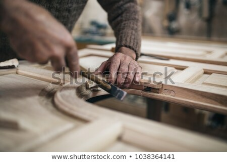Male hands working with hammer and chisel Stock photo © GeniusKp
