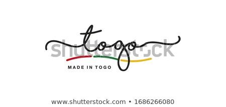 Togo kraju banderą Pokaż tekst Zdjęcia stock © tony4urban