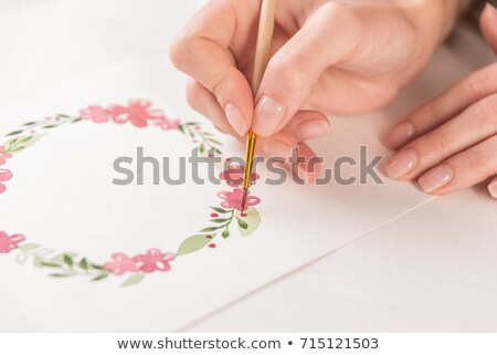 artists hand close up on the background of picture stock photo © master1305