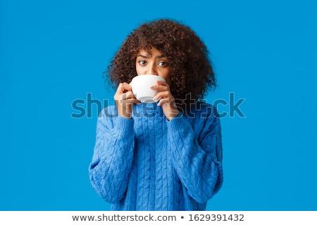 Afro-american woman having a drink Stock photo © iko