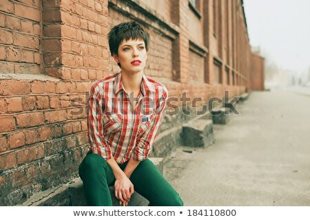 çekici genç kadın gömlek kot şort Stok fotoğraf © deandrobot
