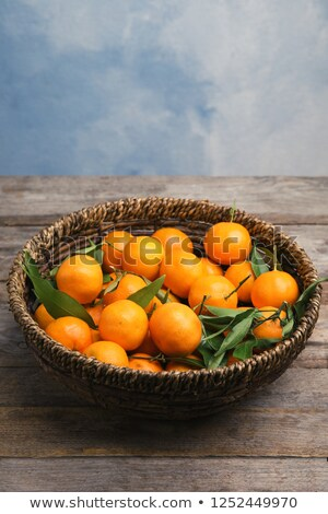 Fresh ripe juicy clementines in a wicker basket Stock photo © ozgur