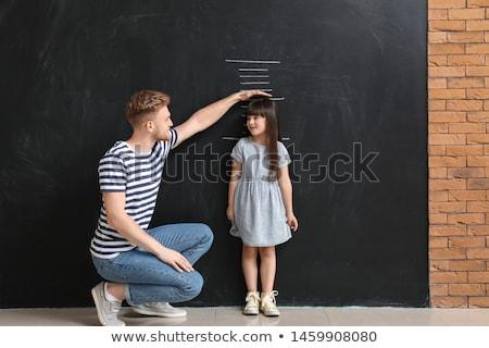 Cute kid measuring his height Stock photo © zurijeta