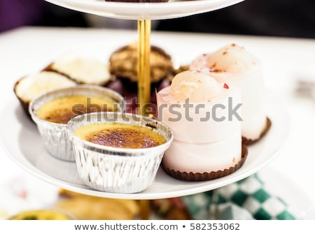 Foto stock: Creme Brulee With Raspberries And Whipped Cream