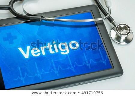 Tablet tanı baş dönmesi göstermek doktor dizüstü bilgisayar Stok fotoğraf © Zerbor