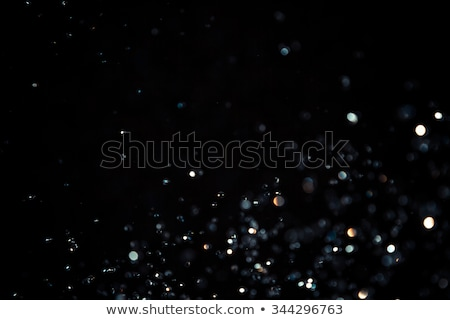 Shiny white diamond on black background.  Stock photo © pakete
