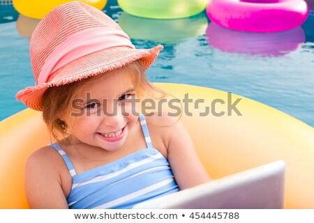 Sorridente loiro menina flutuante amarelo Foto stock © ozgur