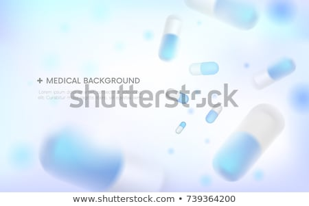 Round white medical tablets on grey background, medicine and healthcare concept     Stock photo © LightFieldStudios